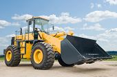 stock photo of wheel loader  - One Loader excavator construction machinery equipment over blue sky - JPG