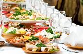 foto of catering  - catering table set service with silverware and glass stemware at restaurant before party - JPG
