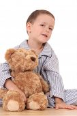 stock photo of teddy-bear  - boy in pijama with his teddy bear isolated on white - JPG