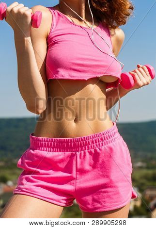 poster of Dumbbell. Sports Fitness Sexy Girl. Muscles With Dumbbell. Woman Training With Dumbbells. Woman With