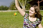 Young woman playing yo-yo in the park