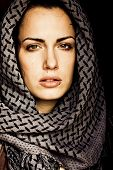 stock photo of arabic woman  - Arab woman using veil with her mouth pierced - JPG
