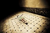 stock photo of seminude  - Young seminude crucified woman on the floor - JPG