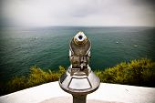 Metal monocular pointing to the Atlantic