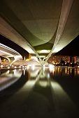 Under urban highway bridge at night.