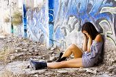Young sad woman in casual clothing