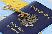 International Travel - passport and skeleton key over map