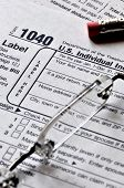 Tax Season - US 1040 Individual income tax form and glasses