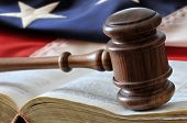 American Law and Justice - gavel, book, and flag background.