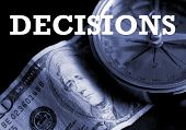 Decisions - concept image with the word 'Decisions' atop US currency and a navigational compass.