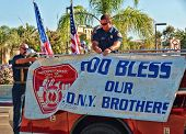 ESCONDIDO, CA - SEP 11: Members of the Escondido Fire Department remember their brethren by attachin