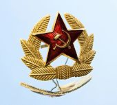 Military badge from the former Soviet Union and reflection on a mirror