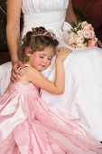 stock photo of flower girl  - Blond Flower girl wearing a pink dress with beadwork - JPG