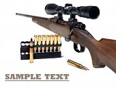 pic of rifle  - Close up of a rifle and bullets on a white background with space for text - JPG