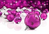 Pink christmas ornaments with star background