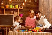 Home Schooling Concept. Little Child With Family On Home Schooling. Son With Mother And Father Play  poster