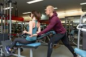 Young Beautiful Woman Doing Exercises With Personal Trainer. Young Adult Personal Fitness Trainer Su poster