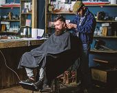 Barber With Clipper Trimming Hair On Nape Of Client. Hipster Client Getting Haircut. Hipster Style C poster