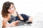 picture of underthings  - Young woman reading magazine isolated on white background - JPG