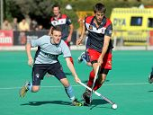 BARCELONA - JAN 7: David Watkins(L) of Monkstown HC vies with Alex Casasayas(R) of RC Polo during a