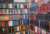 Blurred Image Of Bookshelves In A Public Library. School Library. Education Concept. poster