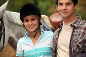 cute female horserider and boyfriend