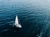 Aerial View Of Sailing Ship Yachts With White Sails In Windy Condition In Deep Blue Sea poster