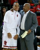 NEW YORK-NOV 3: St. John's Red Storm guard D'Angelo Harrison (L) and assistant coach Darrick Martin