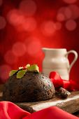Christmas pudding with red bokeh background