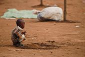 Small African Boy Squatting