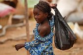 African Girl With Plastic Bag
