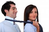 image of male-domination  - Woman leading a man by his tie - JPG