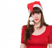 confused woman wearing a christmas hat against a white background