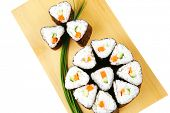 sushi rolls with shnitt onion on wood stand