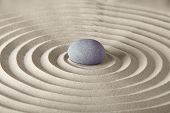 spirituality and purity stone in sand circles spa background in zen garden concept for relaxation co