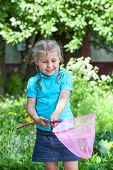 Happy Caucasian Child Looking In Butterfly Net