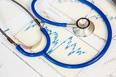stethoscope with financial graph for business insurance concept