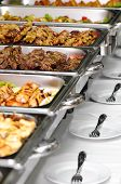 pic of chafing  - banquet table with chafing dish heaters and empty plates