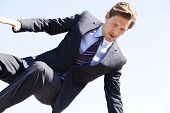 Businessman Jumping Over Something