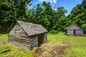 Log cabins at Roaring Fork Motor Trail in Great Smoky Mountains National Forest.