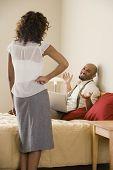 Businessman shrugging shoulders at girlfriend