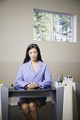 Nail technician sitting at desk