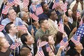image of pacific islander ethnicity  - High angle view of happy multi ethnic people holding American flag - JPG