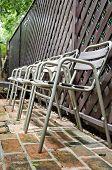 Old Metal  Chair On Brick Floor
