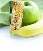 granola bar, green apple and banana - healthy eating