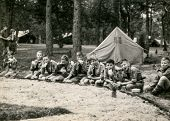 PLOCICZNO, POLAND, CIRCA 1957 - vintage photo of group of scouts during a summer camp, Plociczno, Poland, circa 1957