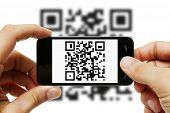 stock photo of barcode  - Close Up Of Male Hands Scanning Qr Code With Mobile Phone - JPG