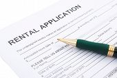 pic of rental agreement  - rental agreement and a pen close up - JPG