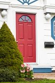 pic of front-entry  - A red front door of an older traditional style American type home - JPG