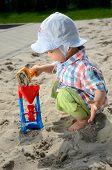 Baby Boy In Sandpit